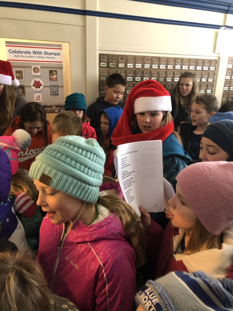 Packing into the Post Office to sing to the friendly mail carriers.